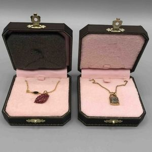 2 Gold tone juicy couture necklaces